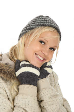 Lovely blond girl with gorgeous smile dressed in winter woolys Stock Photo - 9617414