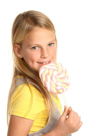 candy stick: Pretty young school girl with a marshmallow candy stick Stock Photo