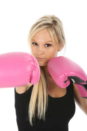 Lovely blonde lady with pink boxing gloves and aggressive expression photo