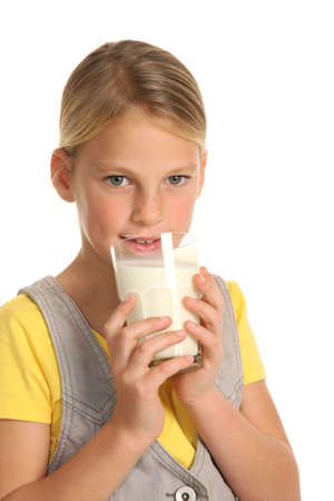 beautiful preteen girl: Pretty young blond girl drinking a healthy glass of milk Stock Photo