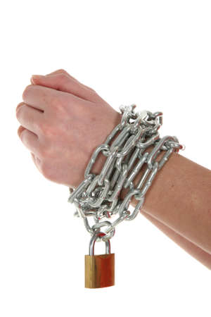 Hands with chain wrapped around them and a brass padlock Stock Photo
