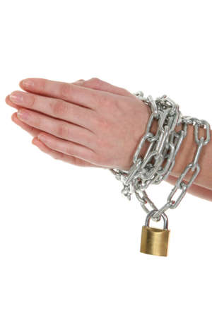 Hands with chain wrapped around them and a brass padlock Stock Photo - 10228222