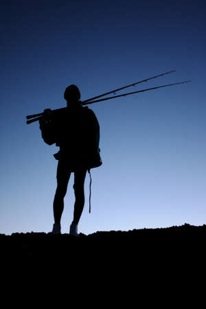 anglers: Silhouette of a fisherman or angler with his fishing rods Stock Photo