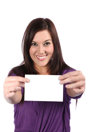 Lovely brunette woman with gorgeous smile holding a blank sign photo