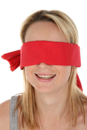 Pretty young blonde lady with a red blindfold over her eyes photo