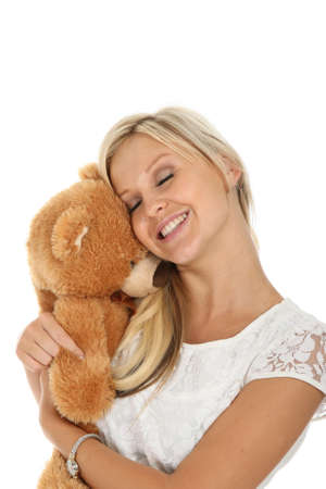 Gorgeous young blond woman hugging a stuffed bear toy photo