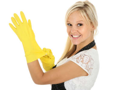 Gorgeous blond housewife putting on protective cleaning gloves photo