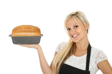 Lovely blond baker woman with a freshly baked loaf of bread photo