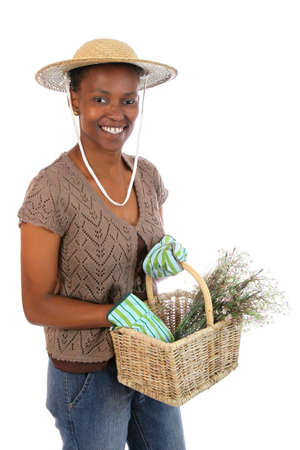 Lovely African American gardening woman with basket of flowers photo