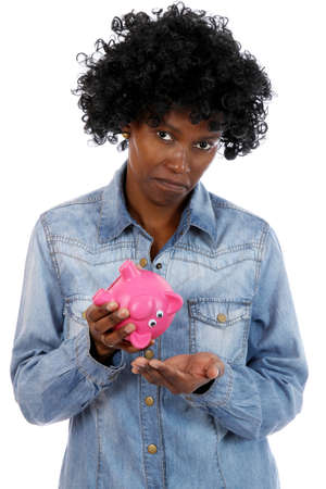 African woman with sad expression and no money left in her piggy bank photo