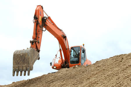 Digging machine excavation in a sandy pit photo