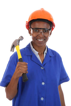 Happy smiling African ethnic lady with hammer and protective safety glasses and hat Stock Photo - 11743947
