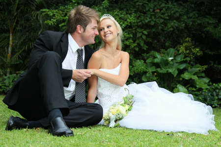 Lovely young couple sitting together on their wedding day Stock Photo - 11744425