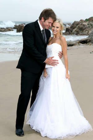 Gorgeous wedding couple on the beach on their special day photo