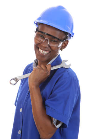 Happy smiling African ethnic lady with spanner and protective glasses and hat photo