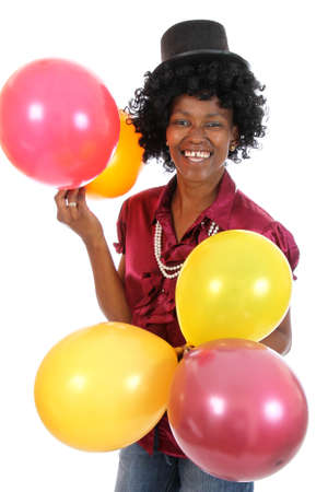 Happy African woman with part balloons and black hat photo