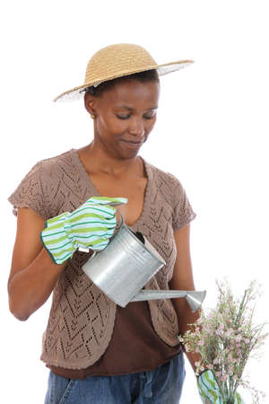 Pretty African wowan with watering can and flowers photo