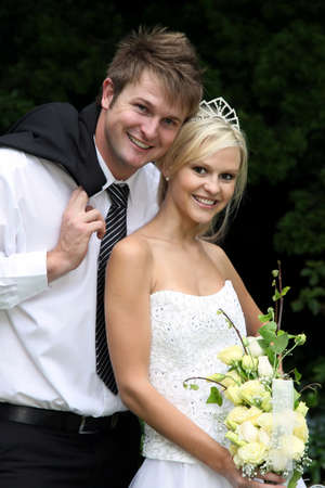 Lovely young smiling couple on their wedding day photo