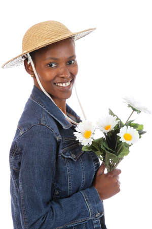 Lovely smiling African woman holding a bunch of flowers photo