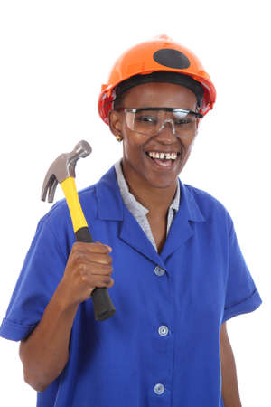 Happy smiling African ethnic lady with hammer and protective safety glasses and hat photo