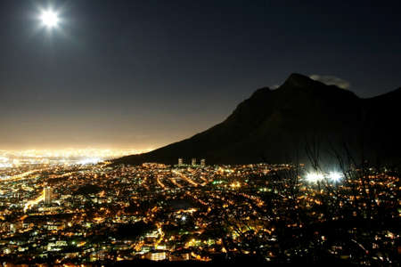 moon  metropolis: Cape Town city at night with moon in the sky Stock Photo