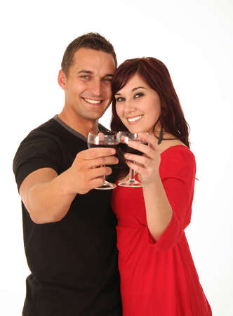 Beautiful happy young couple toasting with their glasses of wine photo