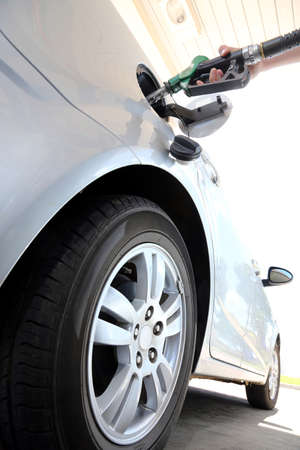 refuel: Petrol or gasoline being pumped into a motor vehicle car Stock Photo
