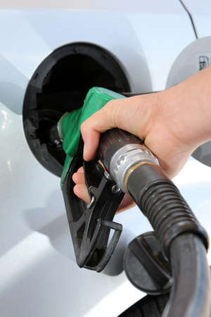 octane: Petrol or gasoline being pumped into a motor vehicle car Stock Photo