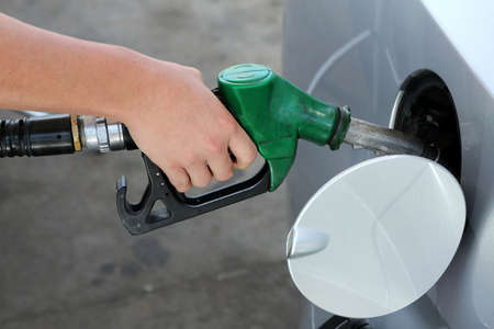 Petrol or gasoline being pumped into a motor vehicle car Stock Photo