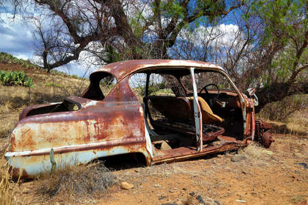 junk car: Old deserted wreck of a car in the Karoo in South Africa