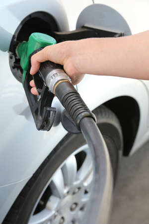 motor vehicle: Petrol or gasoline being pumped into a motor vehicle car Stock Photo