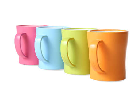 Multi-color coffee or hot drink mugs isolated on white photo