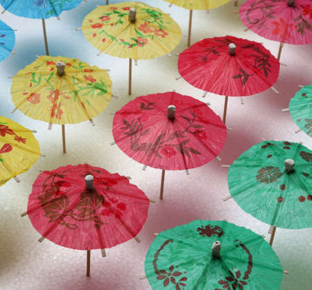 hand crafted: Cocktail umbrellas of different colors arranged in a pattern Stock Photo