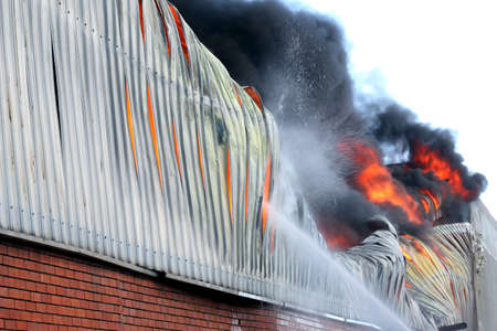 warehouse building: Warehouse building burning with intense flames
