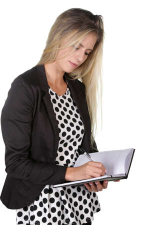 Office worker or manager lady writing notes in her journal or diary photo