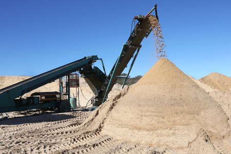 dumping: Conveyor belt dumping clean screened sand for building Stock Photo