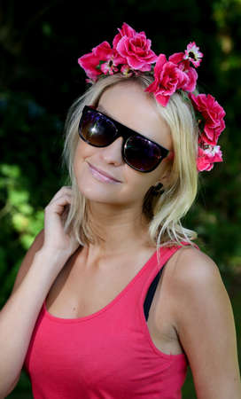 Pretty blond woman with a wreath of pretty spring flowers on her head photo