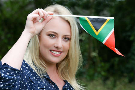 south african: Pretty young lady waving the South African flag