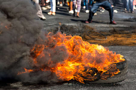 violent: Protesters against the government burning rubber tyres in the streets in South Africa Stock Photo