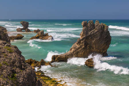 south africa: Beautiful coastline with rock formations at the coast at Kenton on Sea in South Africa