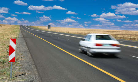 motor vehicle: Motor Vehicle or Car travelling along the highway at speed