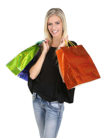 or spree: Lovely blond shopping lady holding colorful bags - isolated