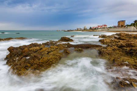 Long exposure of waves washing over rocks at the coast in Port Elizabeth, South Africa