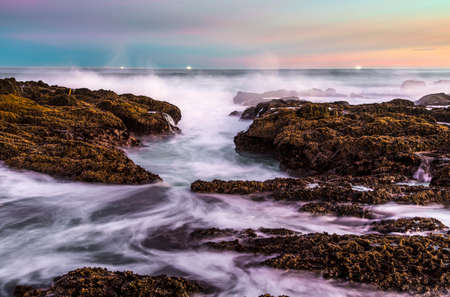 Long exposure of the sea waves and rocks at the coast in South Africa Stock Photo