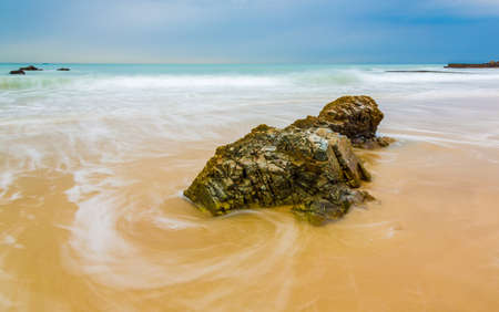 Long exposure of sea sand and rocks at the coast