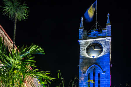 The parliament building in Barbados lit up with colorful festive lights at night