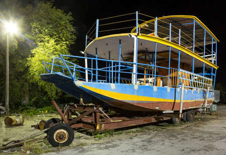 A derelect tourist leisure boat in for repair in Barbados