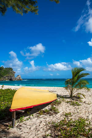 Beautiful coastline and yellow boat on the east side of Barbados Reklamní fotografie