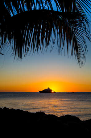 Luxury Yacht on the Sea at Sunset at a tropical island