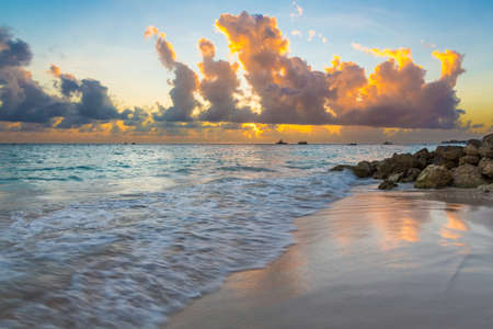 Beautiful Tropical Island Beach Sunset with Blue Water and Clean Sand